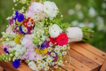 Lynn's bouquet of peonies, bachelor buttons, snapdragons, feverfew, craspedia, and ranuculas.
